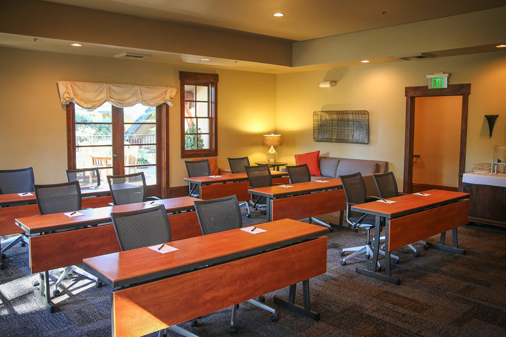 photo of the deodar room set for a small meeting with classroom style setting