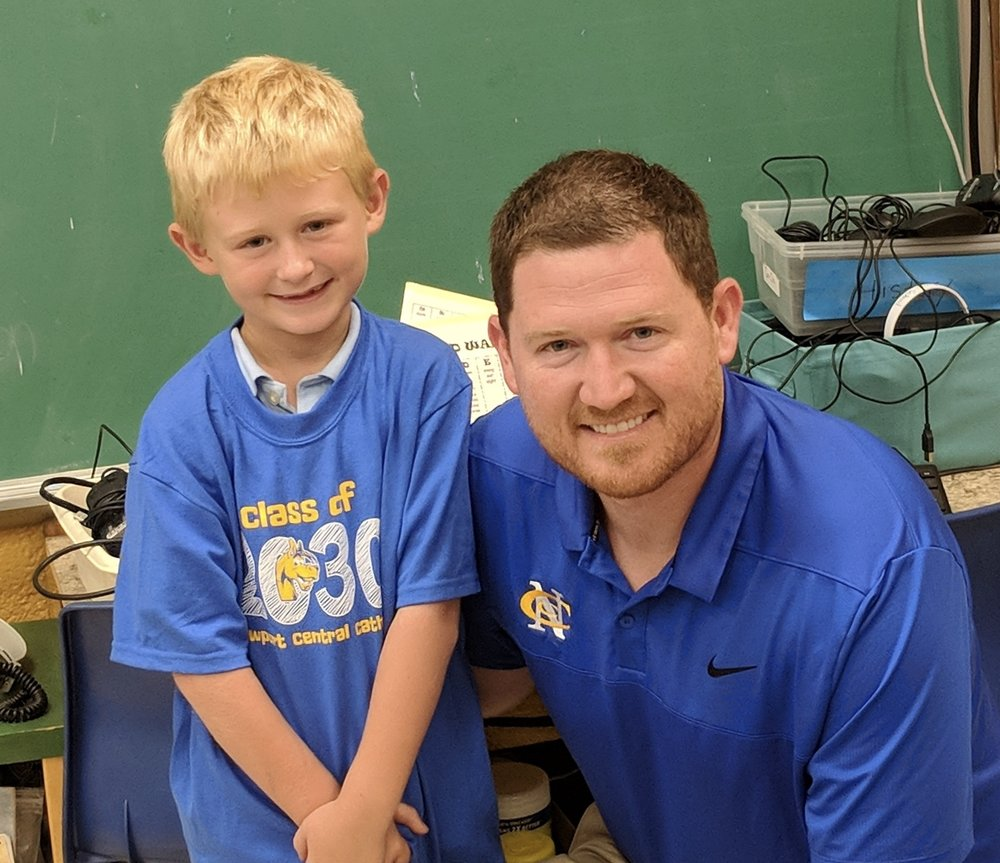 Keegan Collopy, First Grader at St. Catherine of Siena and his dad Mr. Kenny Collopy, Director of Development at Newport Central Catholic High School.