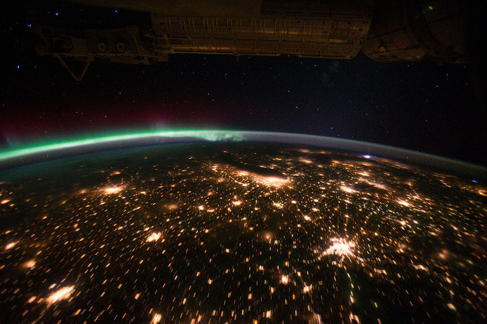 By NASA's Earth Observatory (Midwestern USA at Night with Aurora Borealis) [CC BY 2.0 (http://creativecommons.org/licenses/by/2.0) or Public domain], via Wikimedia Commons