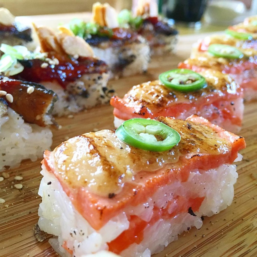 Salmon Oshi Sushi (Foreground) | Spicy Unagi Oshi Sushi (Background)