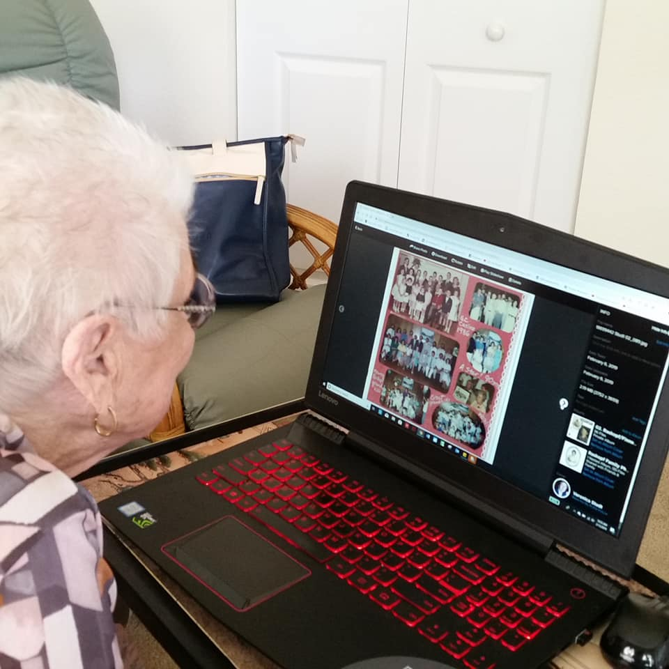 My Aunt exploring our family scrapbook right on my computer!