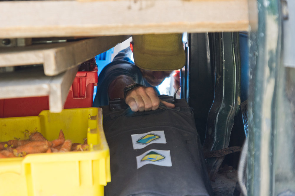 I love this photo of Peter packing one of the tents into the van before market... I feel like packing our market van is a higher stakes game of tetris, photo by Adam Ford.