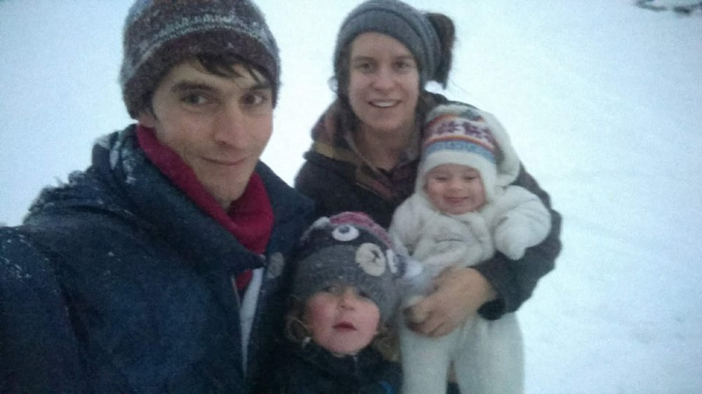 grainy family birthday selfie in the snow