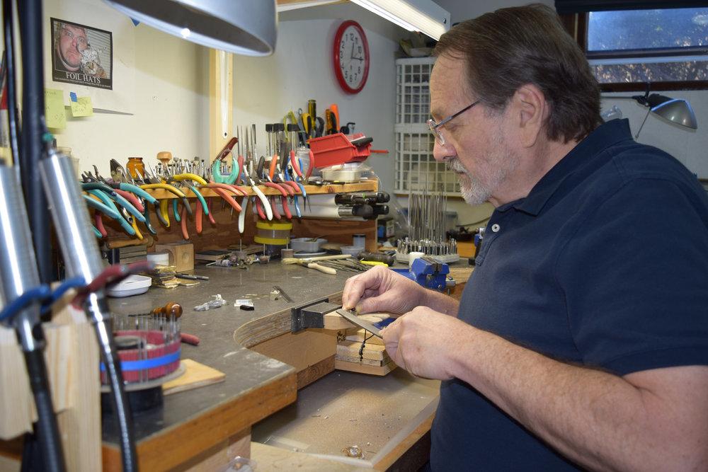 Robert Slater making jewelry