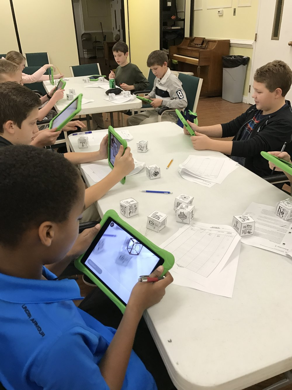 6th graders use an augmented reality app to explore what the elements from the periodic table look like and how they combine with others.