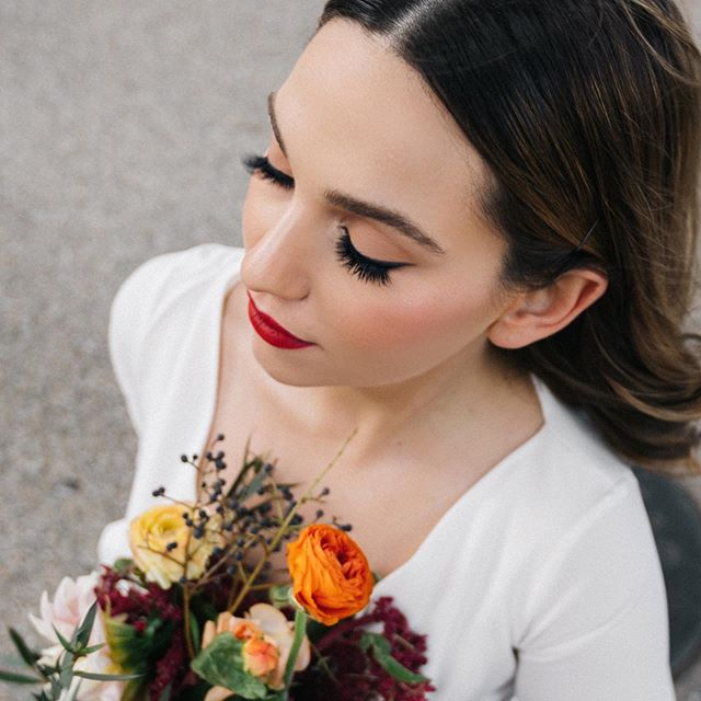 Peachy nude lids and romantic red lips.  #weddinginspiration Would you wear this look on your #weddingday ?  Photography @zoeburchard  Florals @wandering_blooms  Model @_honestlythough  Dress @meagankellydesigns