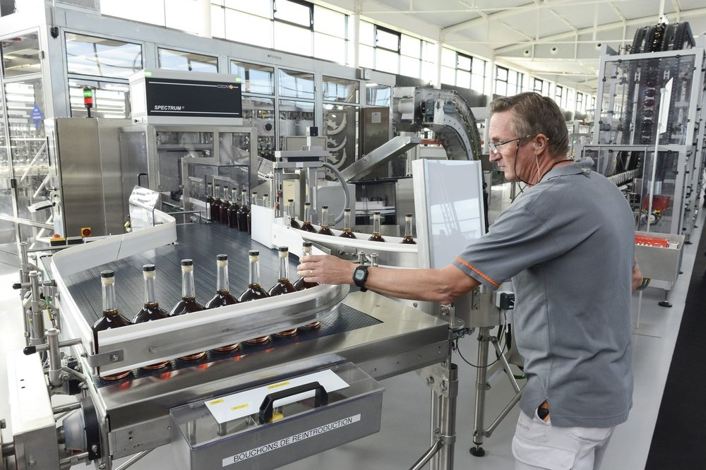 This month Hennessy opened a new plant that is expected to boost shipments by more than 14%. Bottles rattle along a conveyor belt at a rate of 20,000 an hour.  JULIEN FERNANDEZ FOR THE WALL STREET JOURNAL