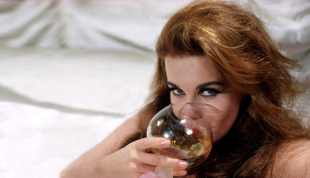 Ann-Margret sips some of the good stuff in the 1975 classic  Tommy .