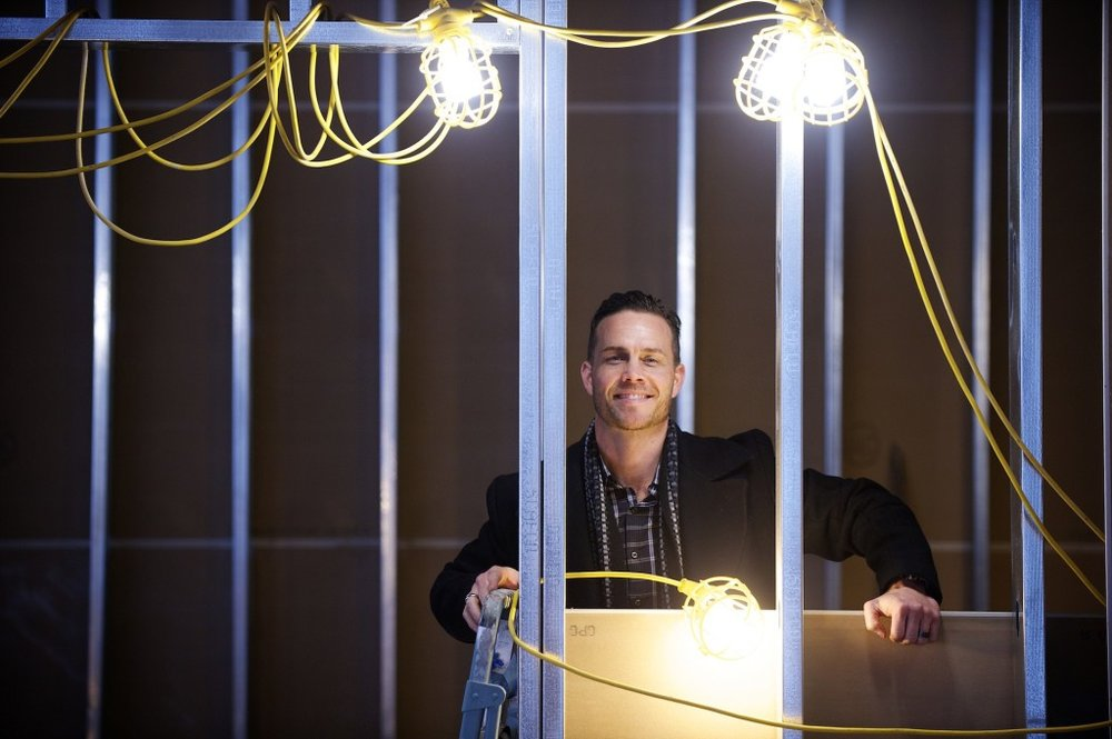Ryan Hurley in the midst of repurposing the Sparks Home Furnishing Building. Photo courtesy of The Columbian, 2015.