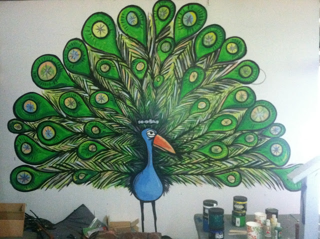 This was my first Peacock Mural down at the Two Crows Surfboards Factory in the Waialua Sugar Mill. Notice a lot more color in his feathers and how there is a more detail coming out. This Mural almost got my face punched in by the North Shore's Graffiti Buster who wanted to make sure I didn't tag anywhere on the North Shore. Which takes us to the next image.