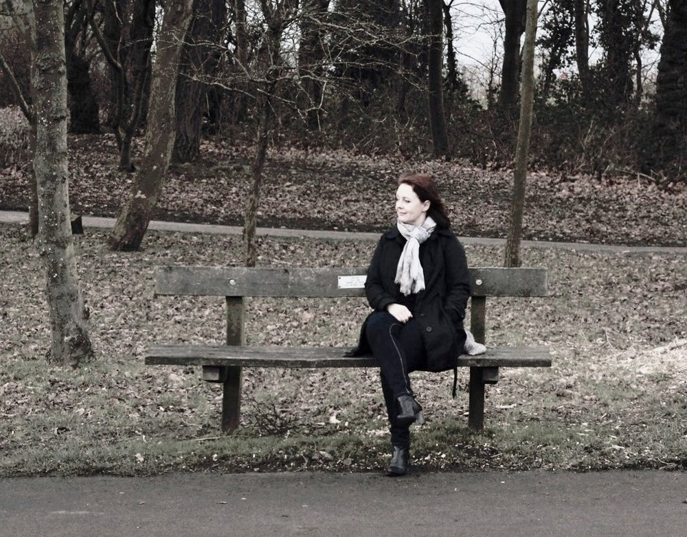 Julie on a bench.JPG