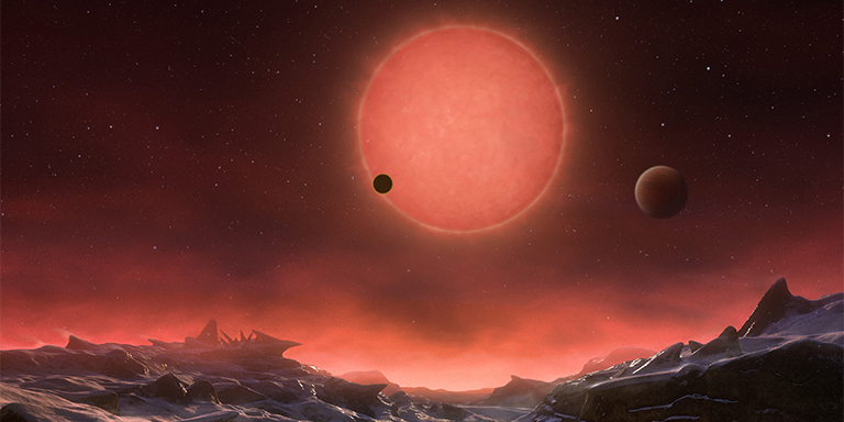 An artist's rendition of the view from the surface of one of the exoplanets of the TRAPPIST-1 system. Image credit:  ESO/M. Kornmesser .