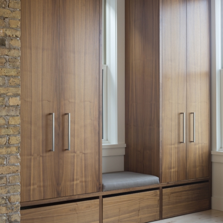 Potomac Mudroom   Flat cut walnut cabinets with integrated finger pulls in natural lacquer finish.