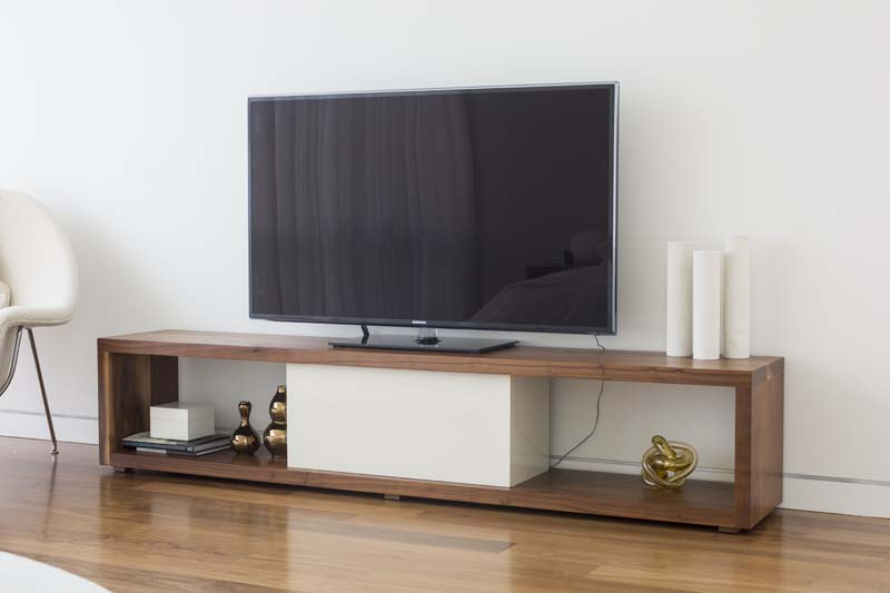 Fremont TV Stand Solid walnut and white lacquer TV stand with lacquer finish.