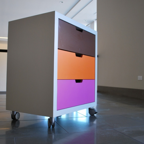Tri-Color Storage Cart Painted MDF double sided storage cart with locking castors.