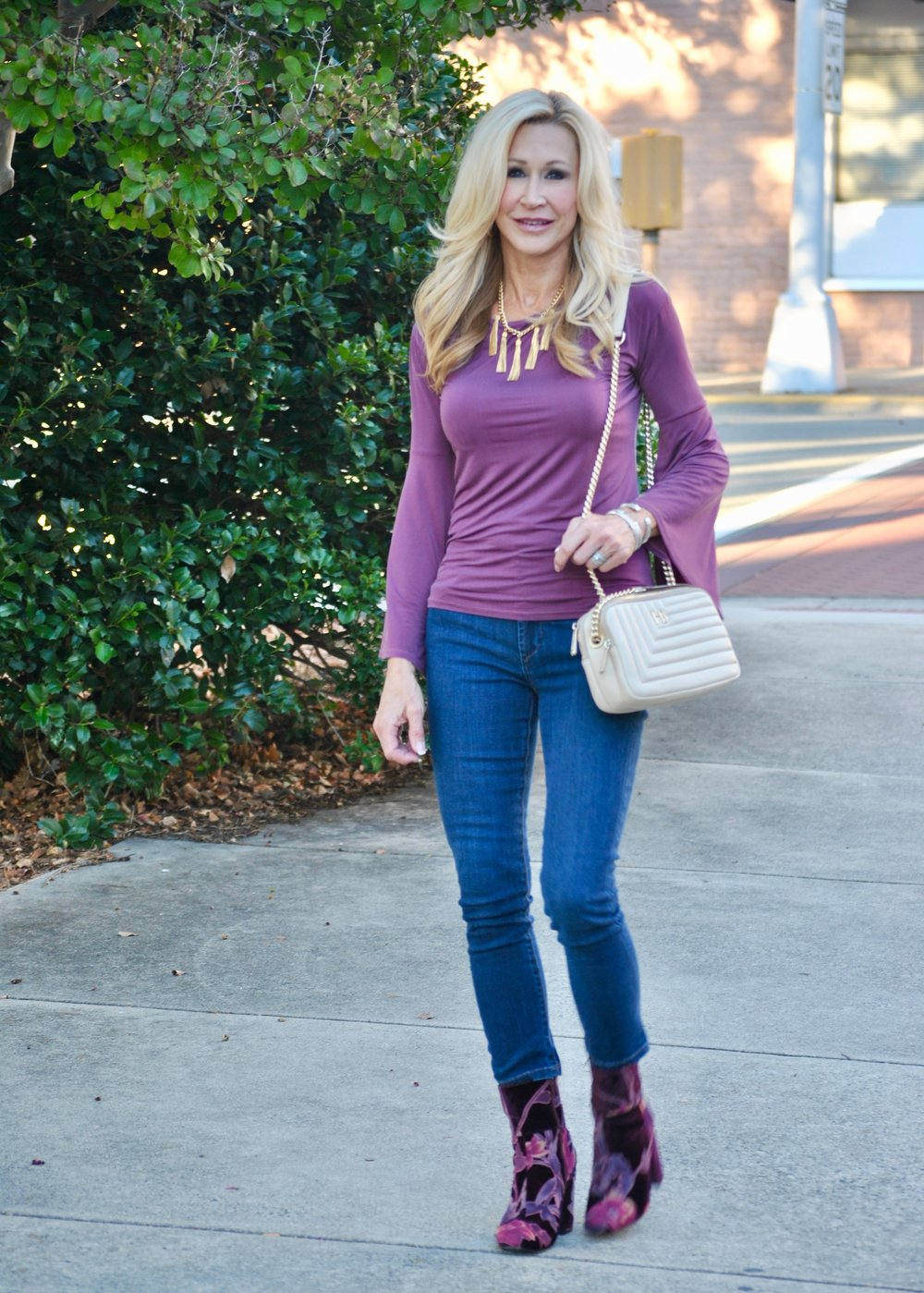 Bell sleeve top with Rachel Zoe necklace and Steve Madden boots