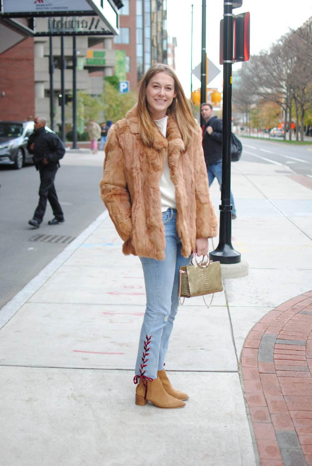 Rebecca dressed in Anthropologie jeans, Henri Bendel Bag and Everlane booties