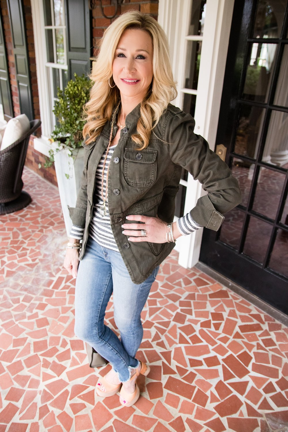Military jacket styled with skinny jeans