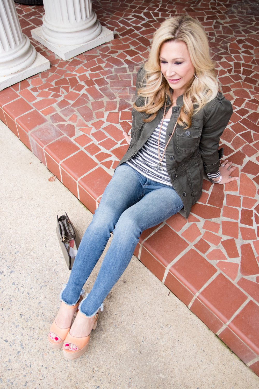 Military Jacket styled with jeans and striped shirt