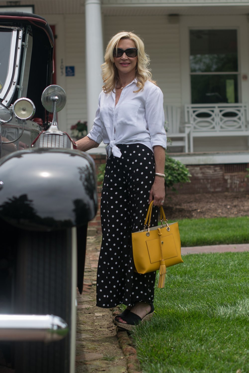 Gaucho Pants with White Blouse and Yellow Henri Bendel Bag