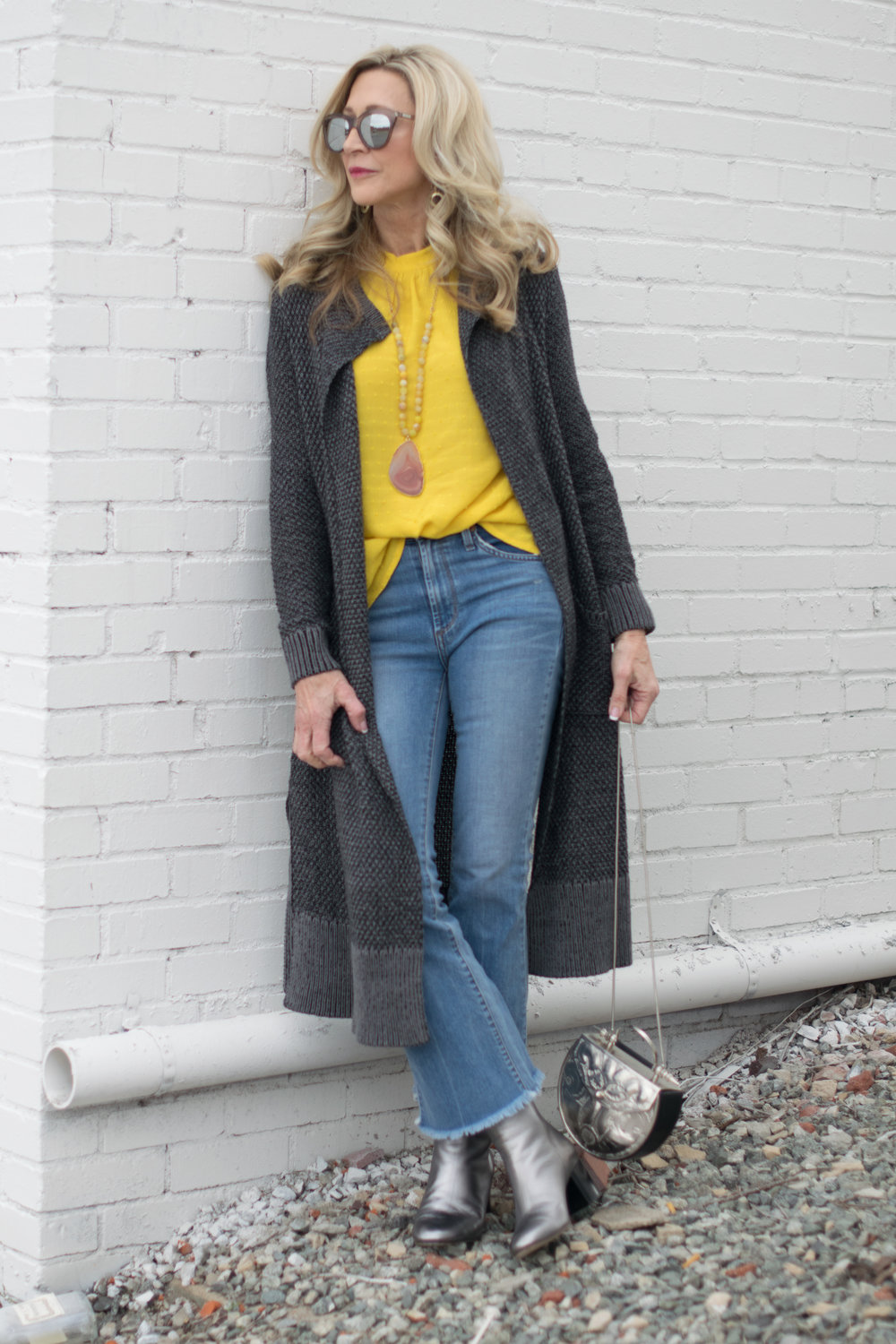 Spring Outfit Idea - Anthropologie yellow blouse with Cabi Sweater and Rag and Bone Booties