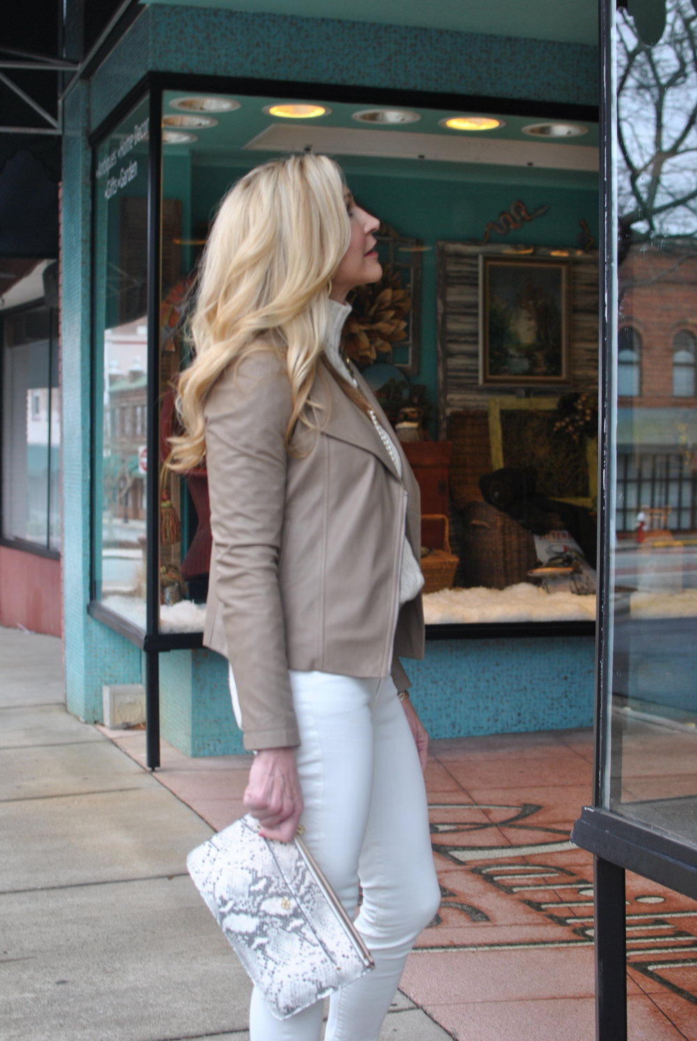 Leather jacket styled with white jeans for winter
