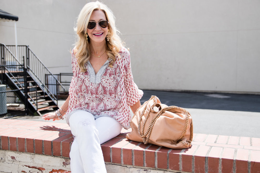 Ulla Johnson top, Stella McCartney bag and Vera Bradley sunglasses