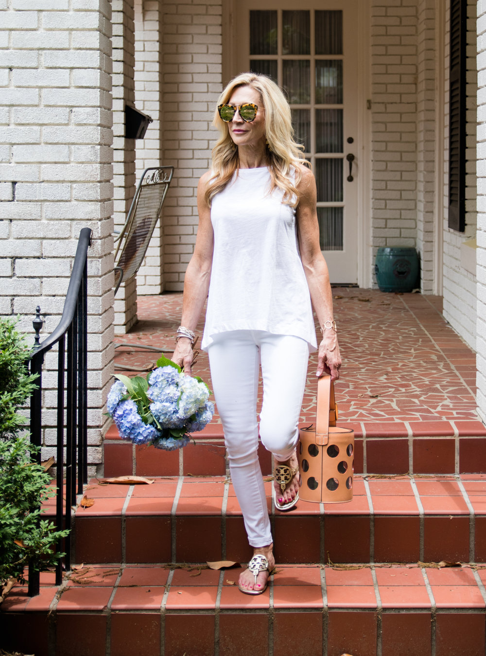 All white outfit with Tory Burch bucket bag and sandals