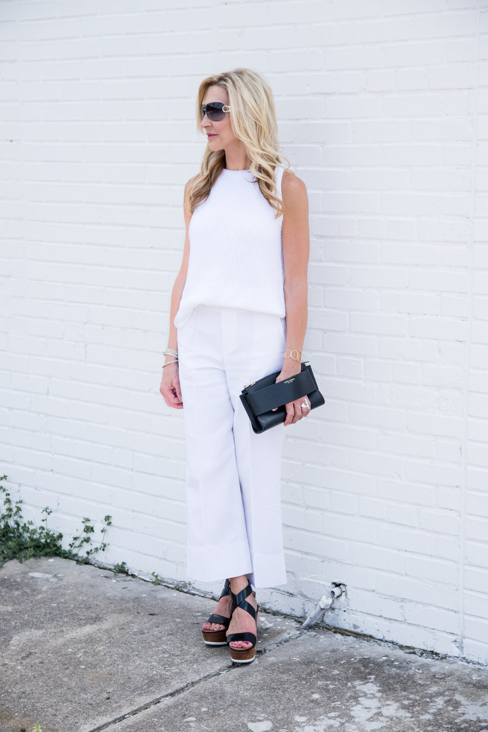 White outfit with black accessories