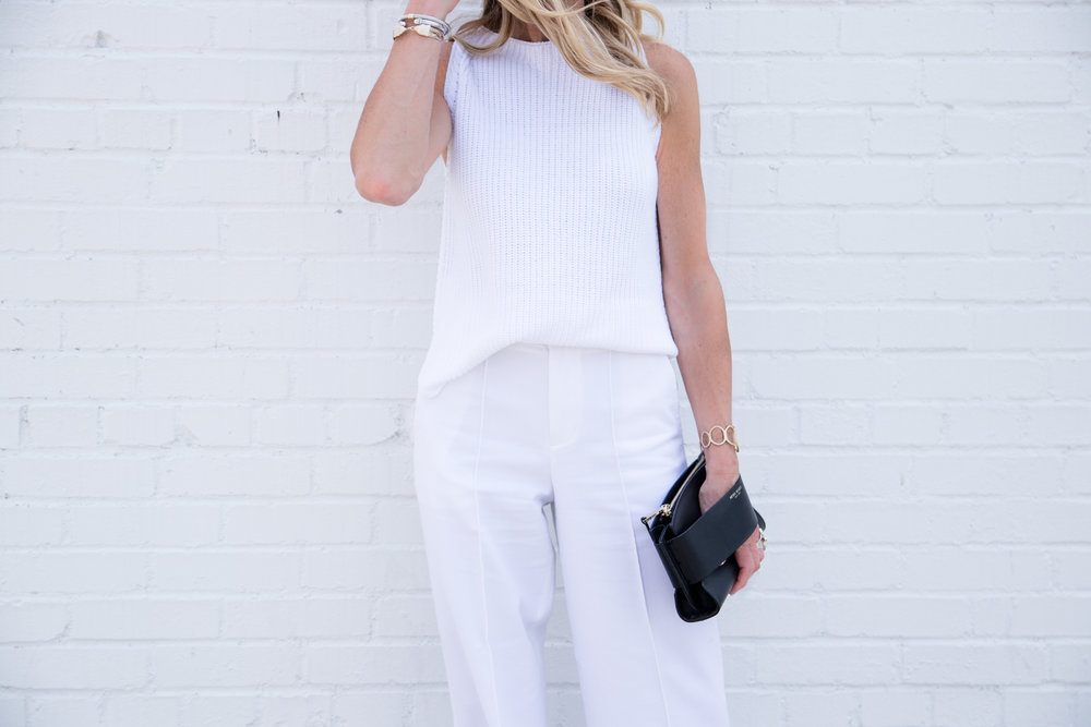 All white outfit with black accessories