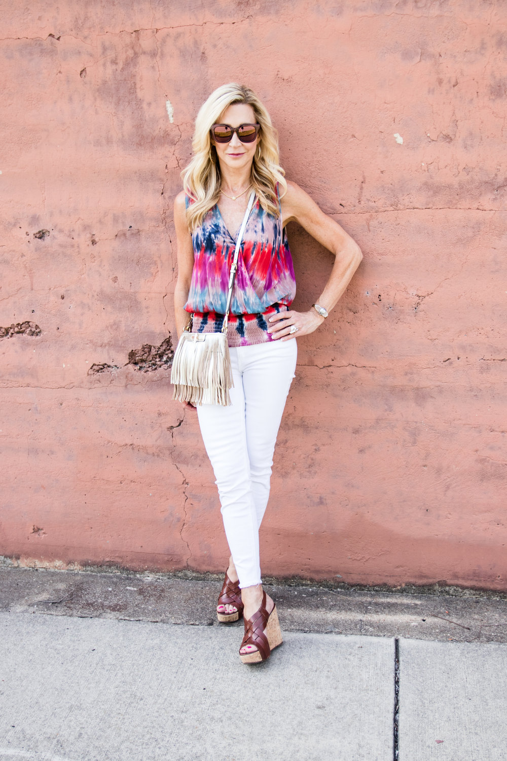 Tie dye blouse, white jeans, Tory Burch wedges and Rebecca Minkoff bag