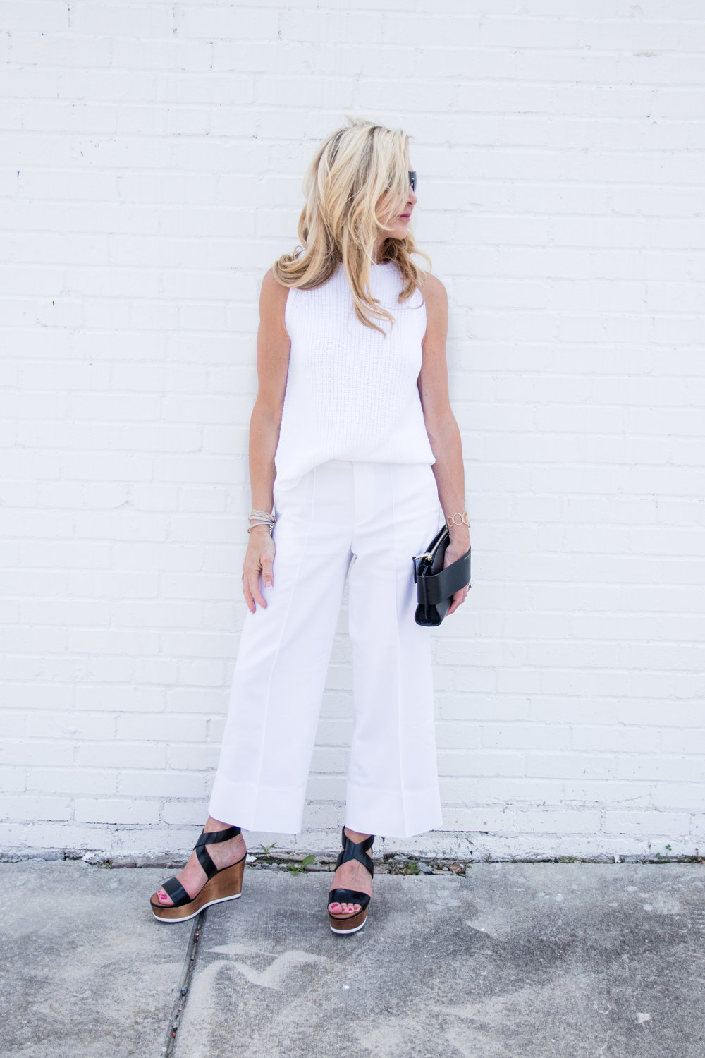 All white...cropped pants, black accessproes