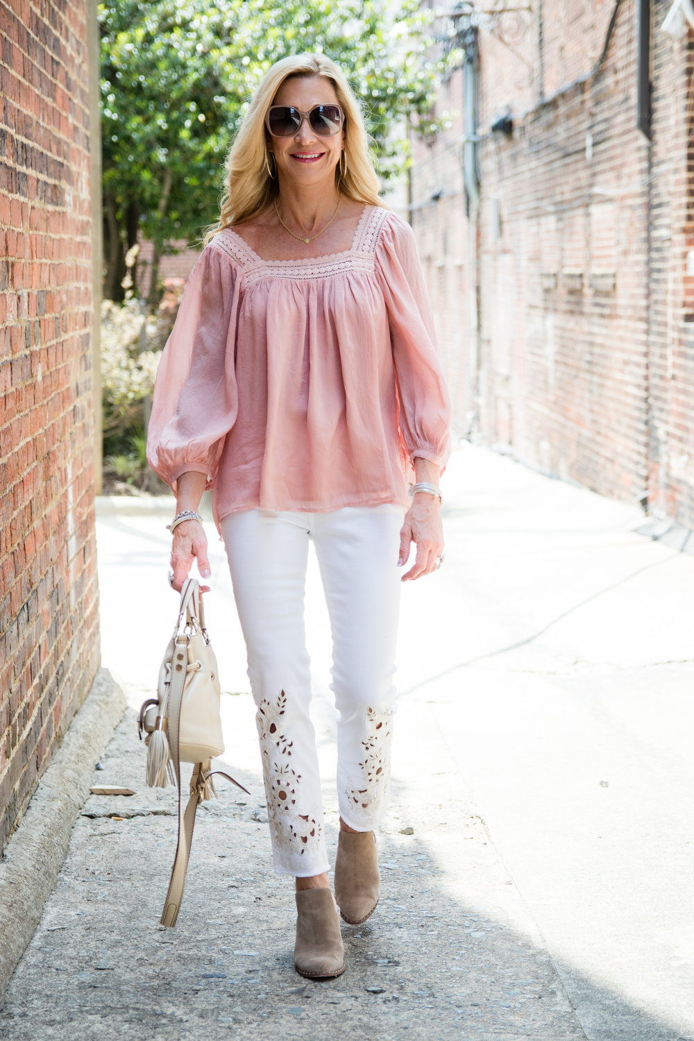 Cutwork detail jeans with boho top and booties