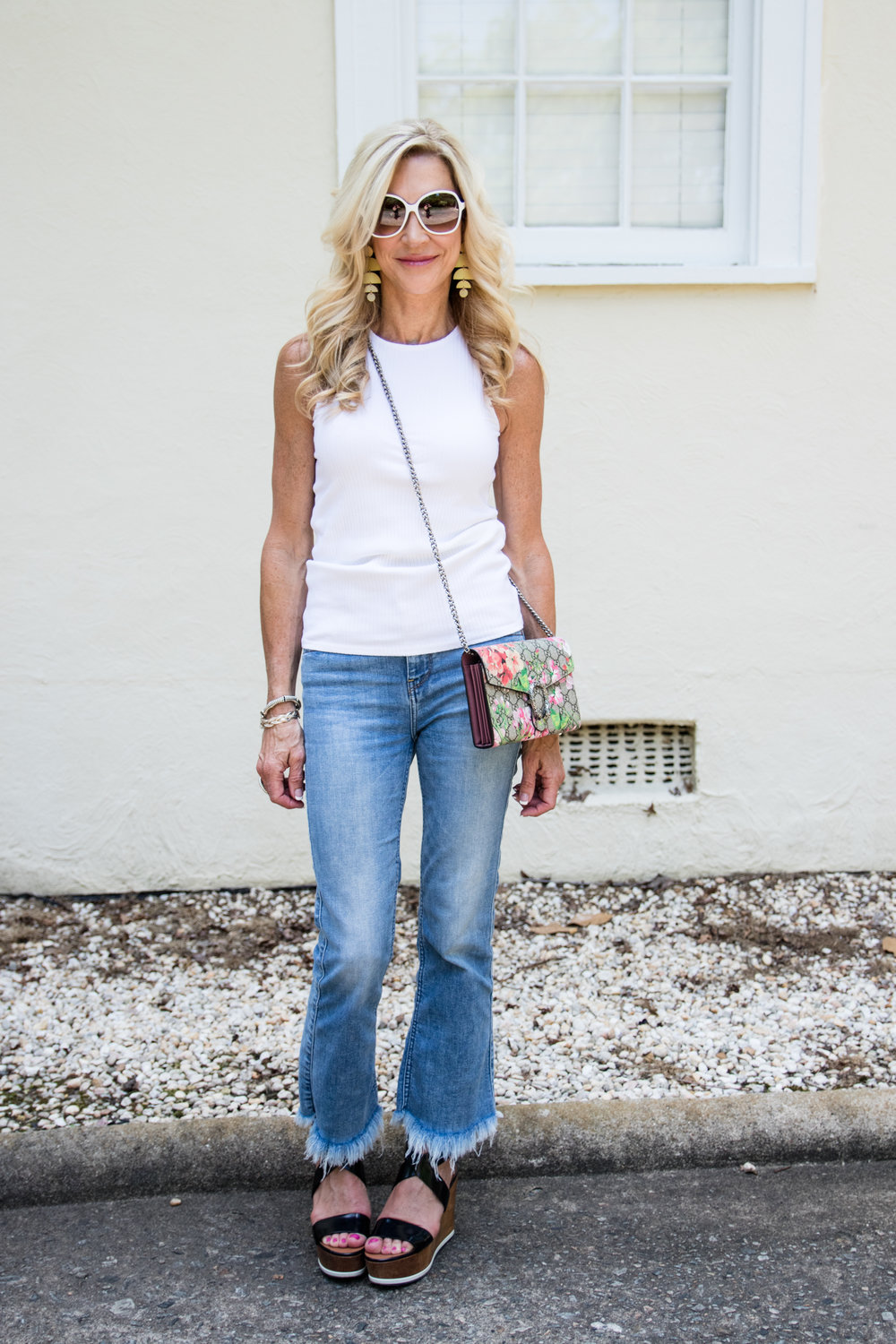Cropped jeans with white top, YSL platforms and Gucci bag