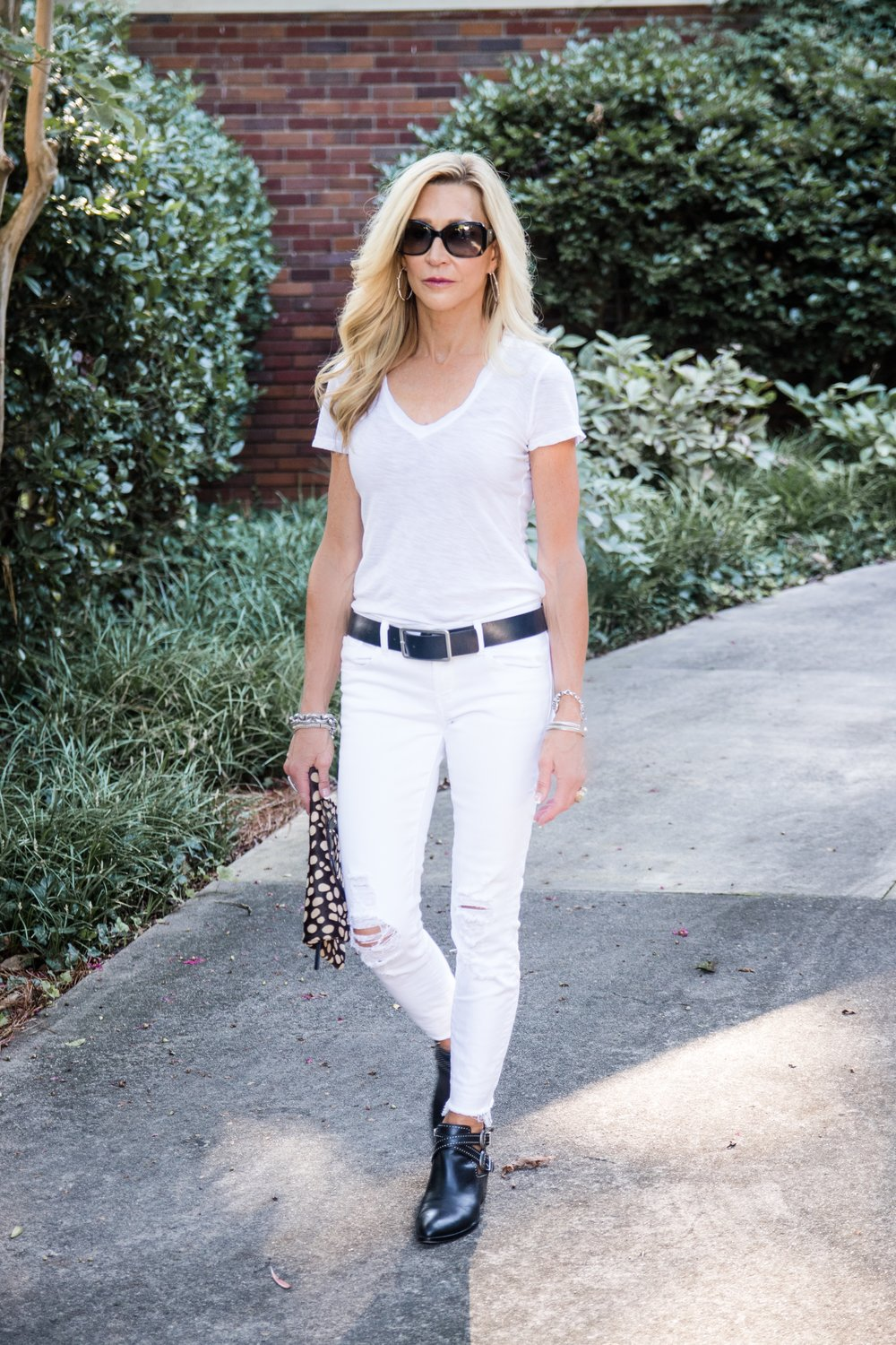 White jeans with dark accessories