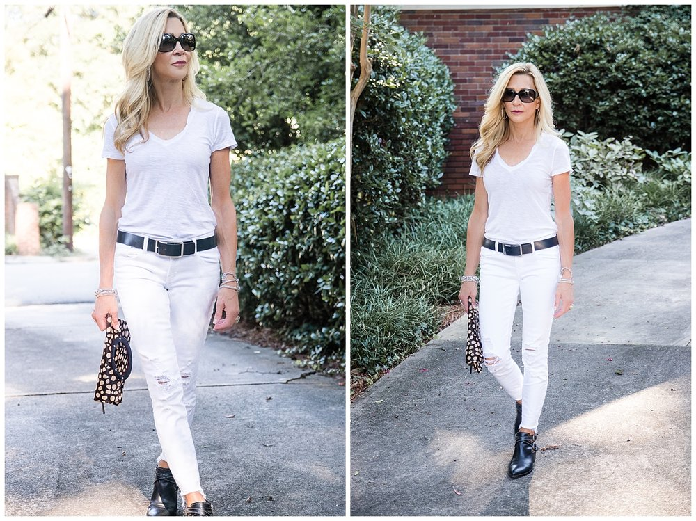 White jeans and tee with dark accessories