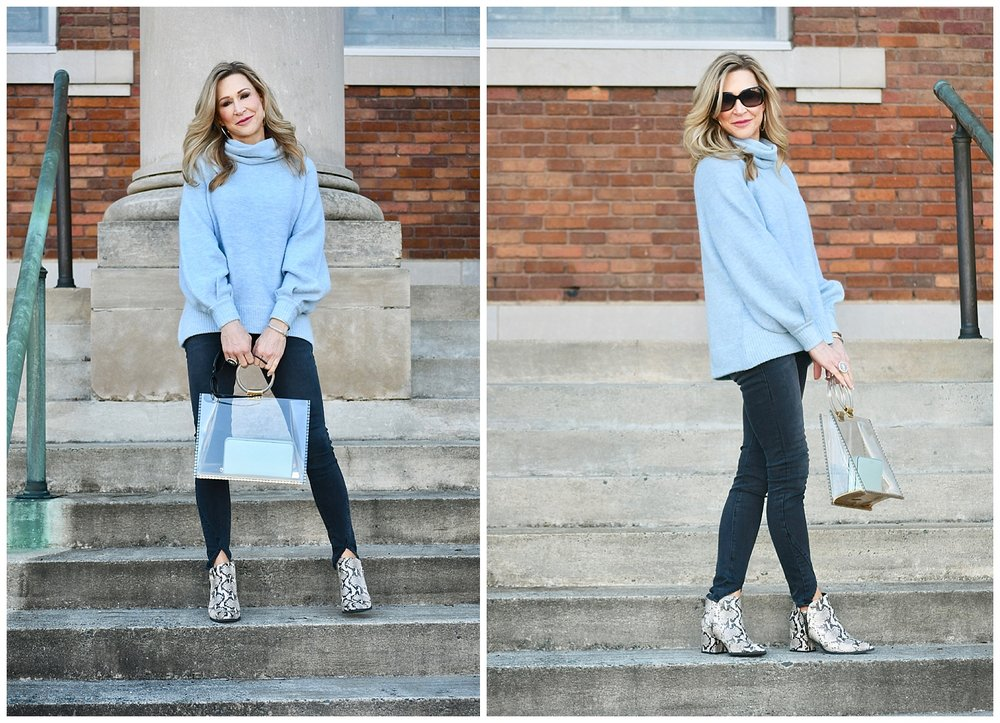 Light blue sweater with grey jeans and snakeskin shoes