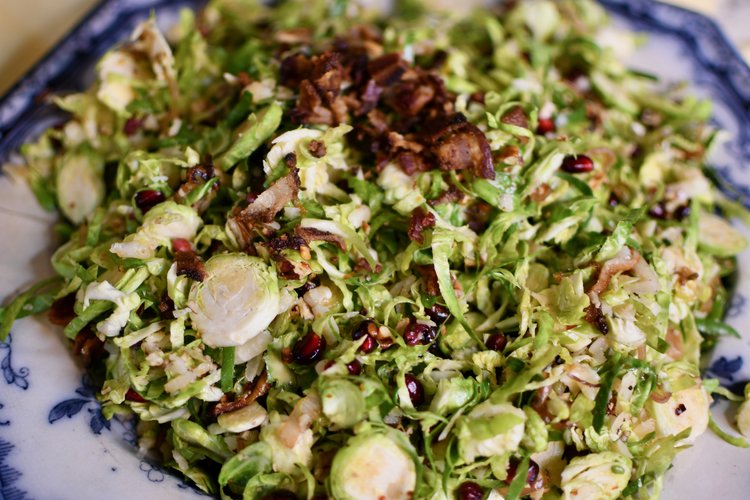 Brussels Sprouts Salad with Pomegranate Seeds, Bacon & Warm Cider Vinaigrette -