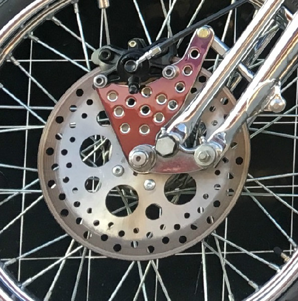 OOO-LA LA!  FRONT BRAKE BRACKET AND MOUNT BY TODD APPLE.  CHROME BY NORTHWEST CHROME SHOP.