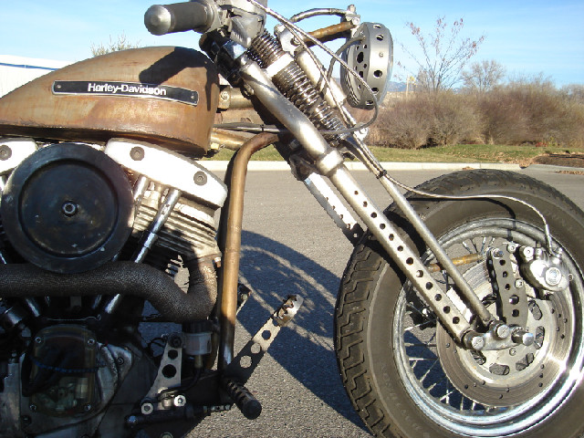 DRILLED SPRINGER FRONT FORK, DRILLED HEADLIGHT, CUSTOM MADE BREAK MOUNT, HAND MADE FORWARD CONTROLS.