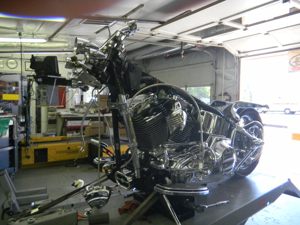 DISASSEMBLING THIS VANDALIZED SOFTAIL FOR REPAIRS.