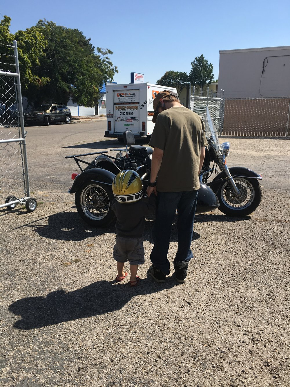 A COUPLE OF AMAZING KIDS (GRANDSON AND SON); STARTING YOUNG WITH HIS FIRST MOTORCYCLE RIDE.
