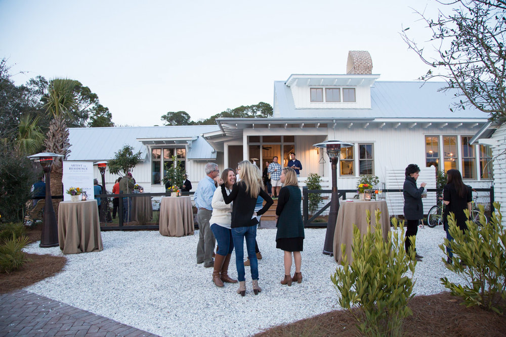Guests gather at the Artist Cottage for light bites and libations on Monday evening