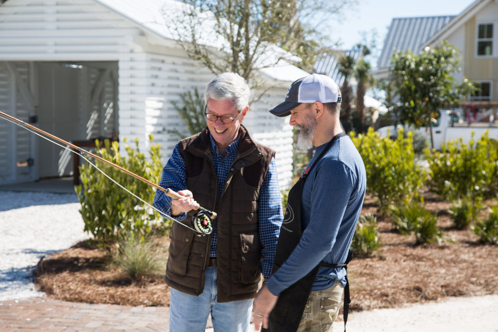 Bill Oyster and a guest test out a fly rod during Gallery Hours at the Artist Cottage.