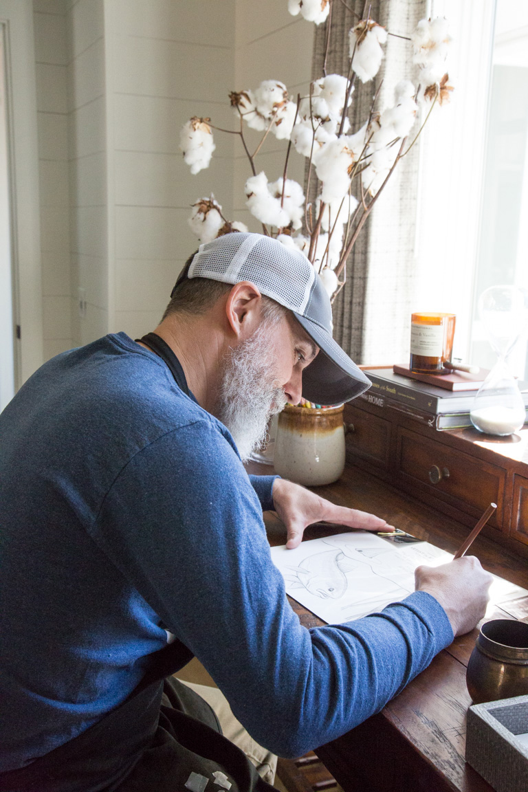 Bill Oyster works on a drawing to leave at the Artist Cottage during Gallery Hours.
