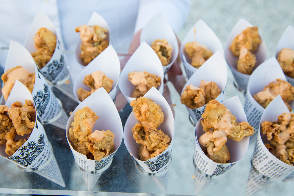 Guests enjoy fried oysters among other delicacies at the Fish Fry.