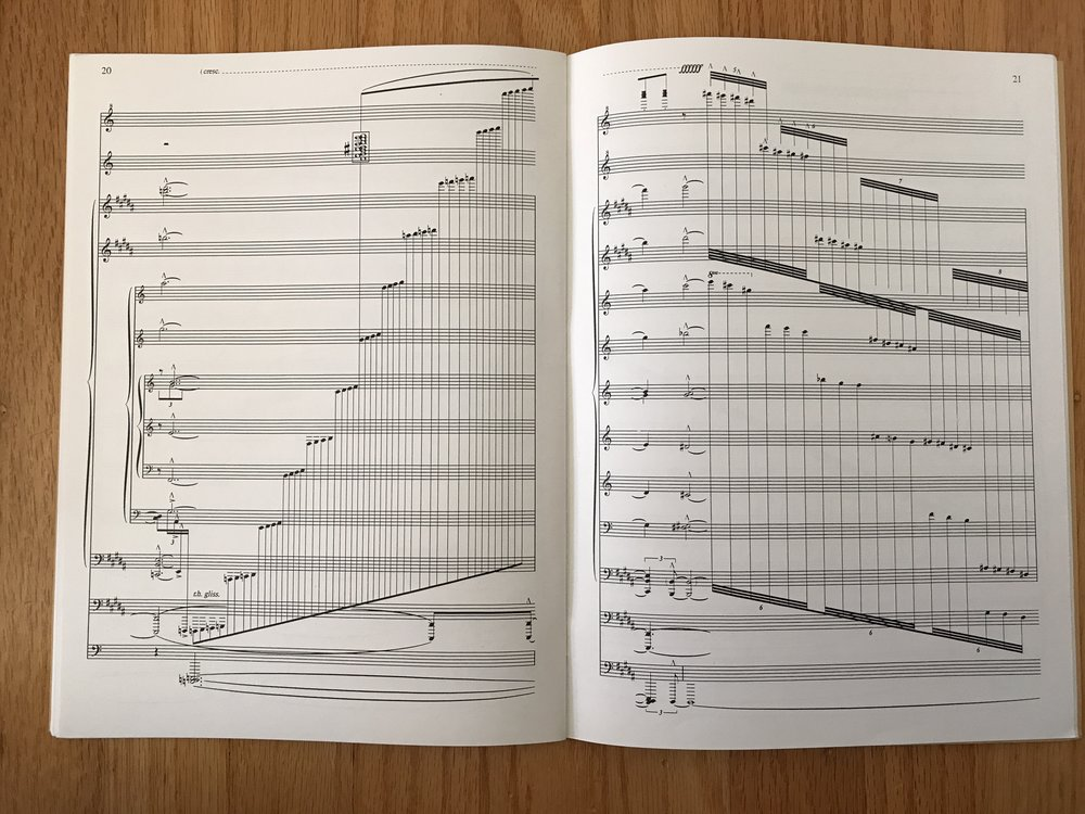 If you thought Rachmaninoff's 4 staves was extra, Mikhashoff more than triples that! At first glance, I'd guess that Mikhashoff employs (/deploys?) an outrageous number of staves to graphically represent the explosiveness/expansiveness of the gesture. A glissando on two staves with 8va lines may sound the all the same but this does look significantly more striking (and ridiculous), which may offer something for the performer's psychology.