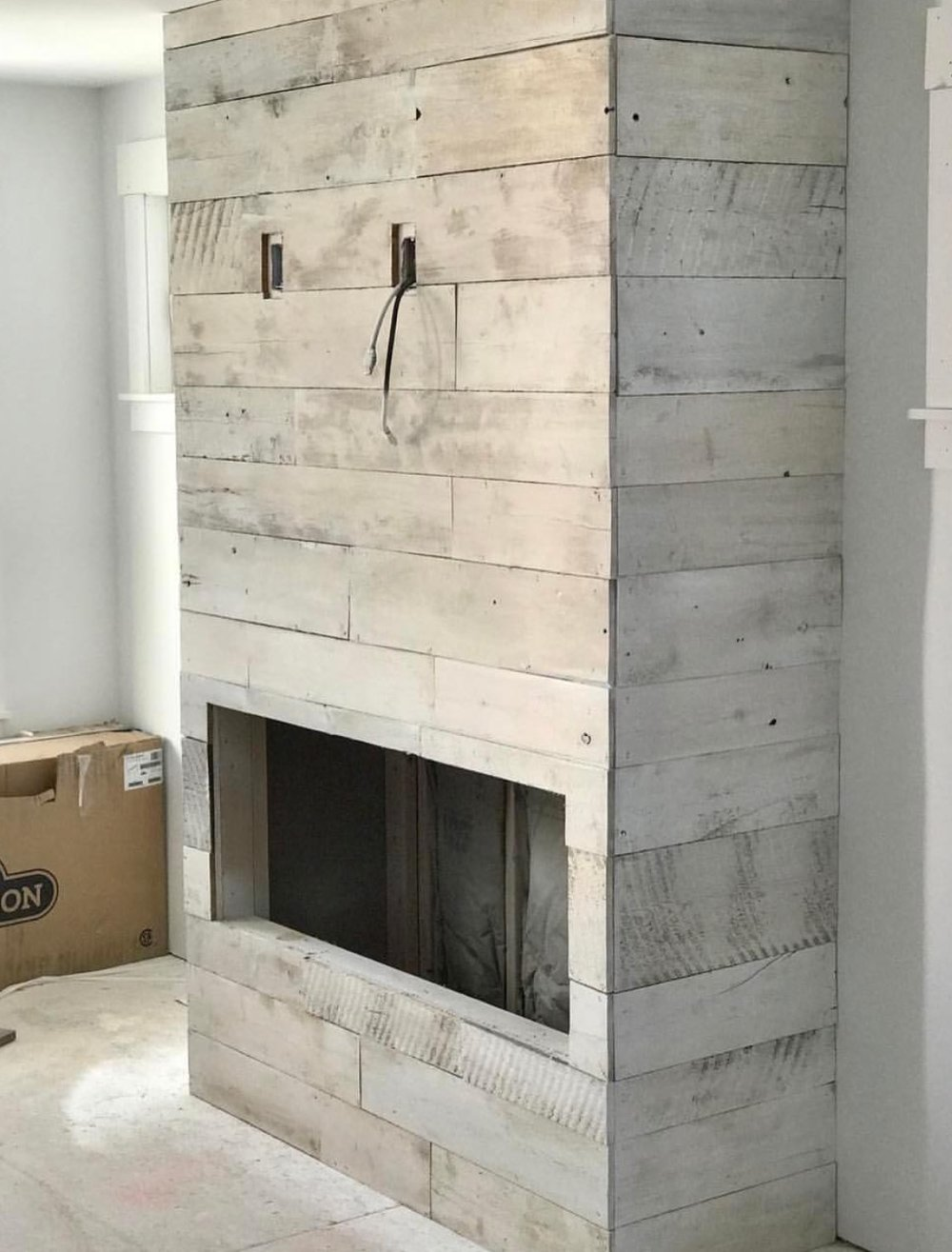 White-wash reclaimed wood fireplace covering