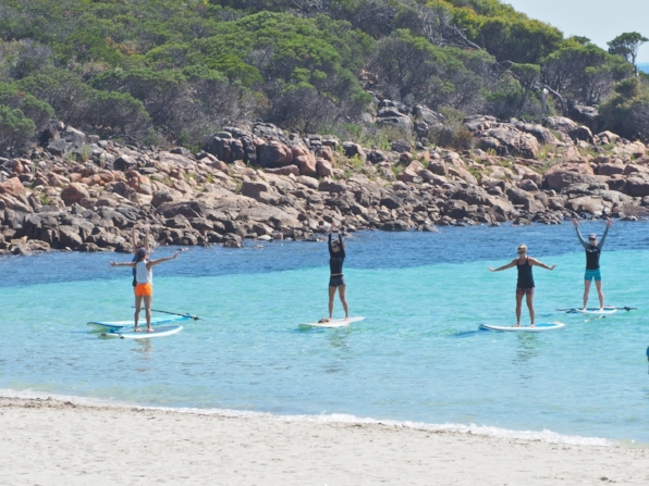 Stand up paddle board yoga is not all heads stands and extreme tricks it can be done by almost everyone and caters for everybody's. Meelup is such a special place to practice yoga. The large trees, green grass and sheltered crystal clear water, make it the ultimate location.