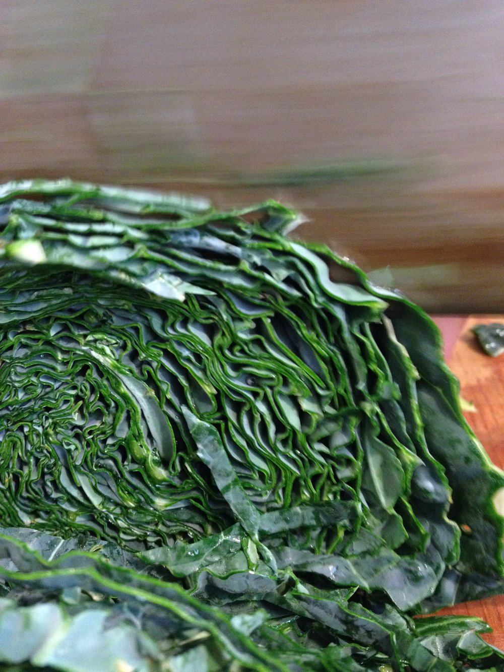 Thinly sliced lacinato kale holds more dressing, which is what we want with a caesar.